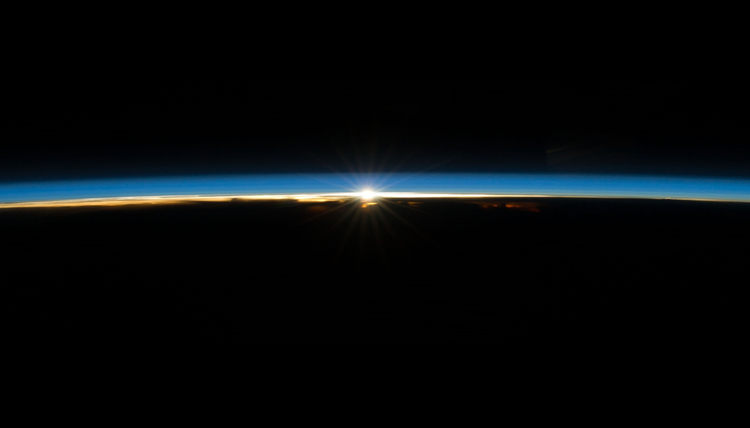 Sun peaking over the edge of the earth